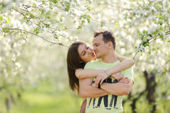 Hugs in Bloomy Garden Stock Image