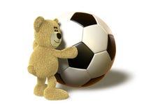 Hugs de urso de Nhi uma esfera de futebol grande Imagens de Stock