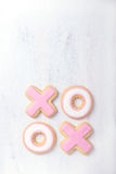 Hugs and kisses shaped Valentine cookies with copyspace Stock Photography