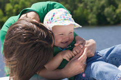 Hugs from mommy Stock Photos