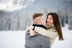 Loving couple hugging in snow Royalty Free Stock Photos