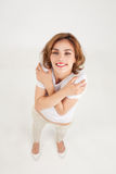 Hugs from a young woman Royalty Free Stock Photography