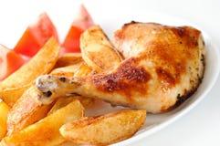 Huhn mit Kartoffeln Stockfotos