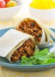 Huhn- und schwarze Bohne Burrito Stockbilder