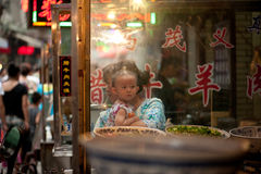 Hui child at the market on lively Muslim Street Royalty Free Stock Photos