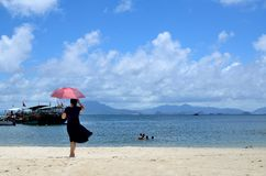 Woman by the sea. Huidong County SunLiaoWan beach. Huidong county is located in Guangdong province of china Royalty Free Stock Image