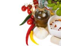 Huile d'olive avec des épices Photographie stock libre de droits