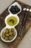 Huile d'olive avec des olives Photos libres de droits