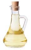 Huile d'olive ou de tournesol dans l'isolat de bouteille en verre Photographie stock libre de droits