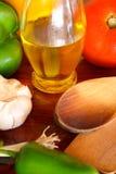 Huile d'olive, poivrons, tomate et ail Images libres de droits