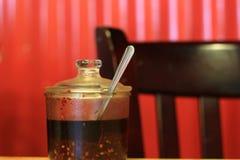 Huile de piment de Szechuan dans un pot de portion Photographie stock libre de droits