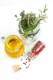 Huile et herbes d'olive Images stock