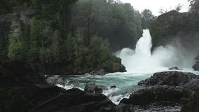 Huilo Huilo Waterfall, Chile. Huilo-Huilo waterfall, located in the Huilo-Huilo Biological Reserve in southern Chile`s Lakes District stock footage