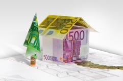Huis dat van geld op plan wordt gemaakt Royalty-vrije Stock Afbeeldingen