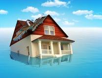Huis dat in water daalt Stock Foto's