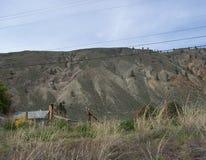 Huis in de heuvels wordt verborgen die Stock Fotografie