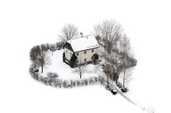 Huis in de sneeuw Stock Foto