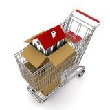 Huis in een open kartondoos Stock Afbeelding