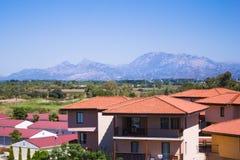 Huis en bergen Stock Foto