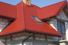 Huis en dak Stock Afbeelding