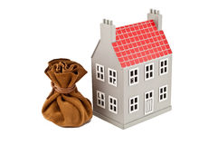 Huis en een zak Stock Foto