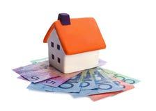 Huis en geld Stock Afbeelding