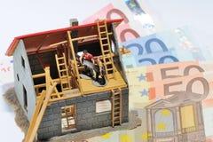 Huis en geld Stock Foto