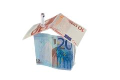 Huis en geld royalty-vrije stock afbeelding