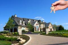 Huis en hand Stock Afbeeldingen