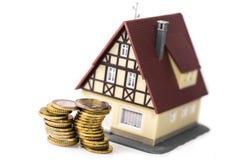 Huis en muntstukken royalty-vrije stock foto's