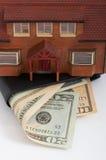 Huis en portefeuille Stock Fotografie