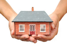 Huis in handen Stock Foto's