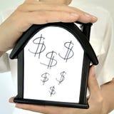 Huis met een dollarteken stock fotografie