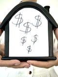 Huis met een dollarteken stock foto