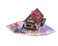 Huis met Euro bankbiljetten en huissleutel Royalty-vrije Stock Afbeelding