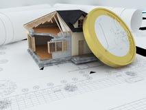 Huis met euro muntstuk Stock Afbeeldingen