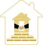 Huis met gouden bakstenen en handdruk Stock Foto