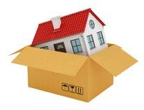 Huis met rood dak in open kartondoos stock illustratie