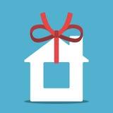 Huis met rood lint Stock Afbeelding