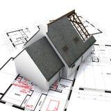 Huis op blauwdrukken Stock Foto