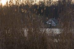 Huis op het meer Stock Foto's