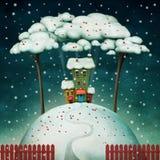 Huis op sneeuwheuvel Royalty-vrije Stock Afbeeldingen