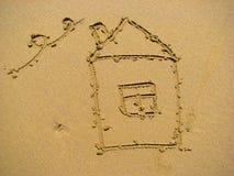 Huis op zand Stock Afbeelding
