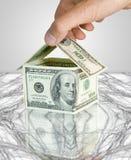 Huis van een geld stock foto