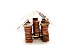 Huis van muntstukken Stock Foto's