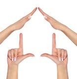 Huis van vrouwelijke die handen wordt op wit worden geïsoleerdc gemaakt dat Royalty-vrije Stock Afbeeldingen