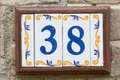 Huisnummer 38 teken in keramische tegels Royalty-vrije Stock Foto's