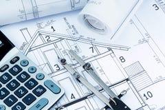 Huisplan met calculator Royalty-vrije Stock Foto's