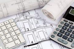 Huisplan met calculator Stock Fotografie
