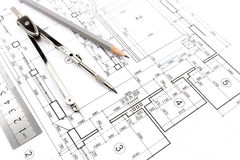 Huisplannen en kompas Stock Foto's